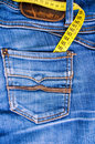 Measure tape and blue jeans Royalty Free Stock Photos