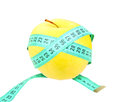Measure tape on yellow apple Royalty Free Stock Photo