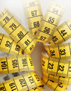 Measure yellow metric tape short depth of field Royalty Free Stock Photo