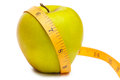 Measurement green apple white background Royalty Free Stock Photo