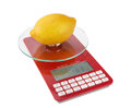 Measurement and weight calorie fruit lemon on special scales close up Stock Photography