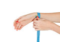 Measurement of wrist young slim woman measures the after sports isolated on white background Royalty Free Stock Photography
