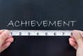 Measuring achievement tape measure aligned against Royalty Free Stock Image
