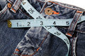 Measuring Blue Jeans Stock Photo