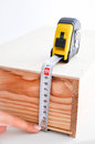 Measuring a box with roulette wooden an yellow Stock Image
