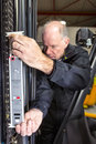 Measuring the chain man of a forklift Stock Images