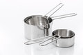Measuring cups made of stainless steel on white Royalty Free Stock Photo