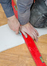 Measuring and cutting gypsum plasterboard male hands Royalty Free Stock Images