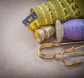 Measuring flexible ruler thread spool safety pins thimbles Royalty Free Stock Photo