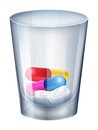 A measuring glass with capsules and tablets Royalty Free Stock Photos