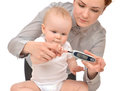 Measuring glucose level blood test from diabetes child baby