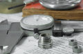 Measuring metal components on the table Royalty Free Stock Photography