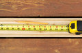 Measuring New Boards for Outdoor Deck Royalty Free Stock Photo