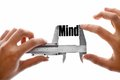 Measuring our minds two hands holding a caliper the word mind Stock Images