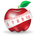 Measuring tape around fresh red apple Stock Photo