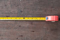 Measuring Tape on board Royalty Free Stock Photo