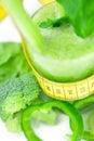 Measuring tape,broccoli,pepper,celery and celery juice