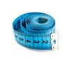 Measuring tape closeup view of blue isolated over white background Royalty Free Stock Photos