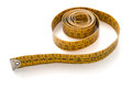 Measuring tape a coiled yellow extending out towards the viewer Royalty Free Stock Image