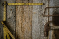 Measuring Tape Hammer and Saw on Rustic Old Wood Royalty Free Stock Photo