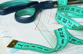 Measuring tape and scissors on patterns Stock Photography
