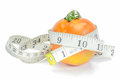 Measuring tape with tomato. Royalty Free Stock Photo