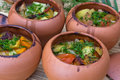 Meat baked with vegetables in rustic clay pot Royalty Free Stock Photos