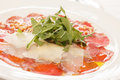 Meat carpaccio with parmesan cheese Stock Photos