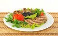 Meat cut into slices beautifully decorated with lettuce and tomato Royalty Free Stock Image
