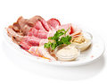 Meat delicatessen plate with souce Stock Images