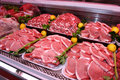 Meat department shelf with products in a new supermarket in rome italy pork chop Royalty Free Stock Image