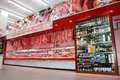 Meat department and wine shelves with products fridge with bottles of in a new supermarket in rome italy Royalty Free Stock Photos