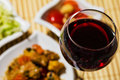 Meat dish gourmet food with salad glass of red wine Royalty Free Stock Photos