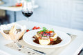 Meat dish with tomatos red wine in restaurant Royalty Free Stock Images