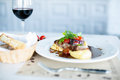 Meat dish with tomatos red wine in restaurant Stock Photography