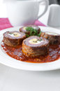 Meat and egg rolls in tomato sauce Royalty Free Stock Photo