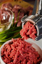 Meat grinder and mincemeat Royalty Free Stock Photo