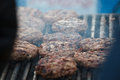Meat for a hamburger on the grill roasting Royalty Free Stock Photo