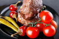Meat medallion with cherry tomatoes Stock Image