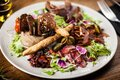 Meat platter for two served on a plate in restaurant Royalty Free Stock Photo