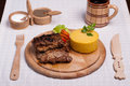 Meat with polenta on the wood with re wine Royalty Free Stock Images