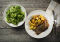 Meat and potatoes roasted with salad close up shoot Royalty Free Stock Photography