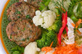 Meat rissoles with vegetables Royalty Free Stock Photo