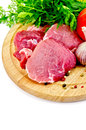 Meat on a round plate with vegetables and herbs Royalty Free Stock Photo