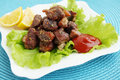 Meat with sauce and lemon spicy fried fresh lettuce leaves Stock Photo