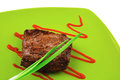 Meat savory : grilled beef fillet mignon on green plate Royalty Free Stock Photo