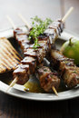 Meat skewer with herbs lime and pita bread Royalty Free Stock Images