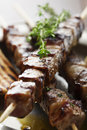 Meat skewer with herbs lime and pita bread Stock Images