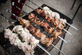 Meat skewers on barbecue Royalty Free Stock Photo