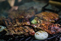 Meat steak on grill with vegetables Royalty Free Stock Photo